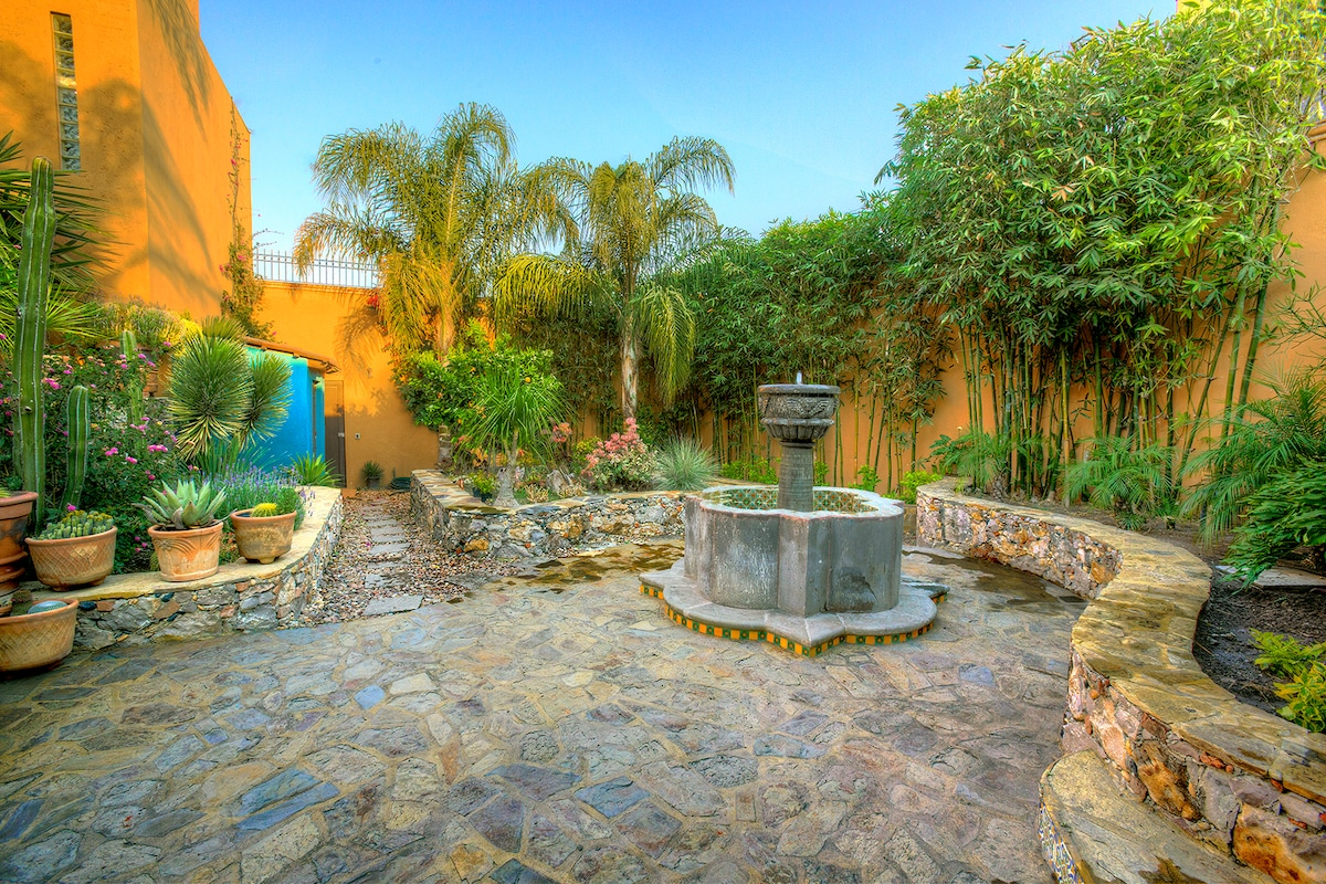 2nd patio with cantera fountain and gardens