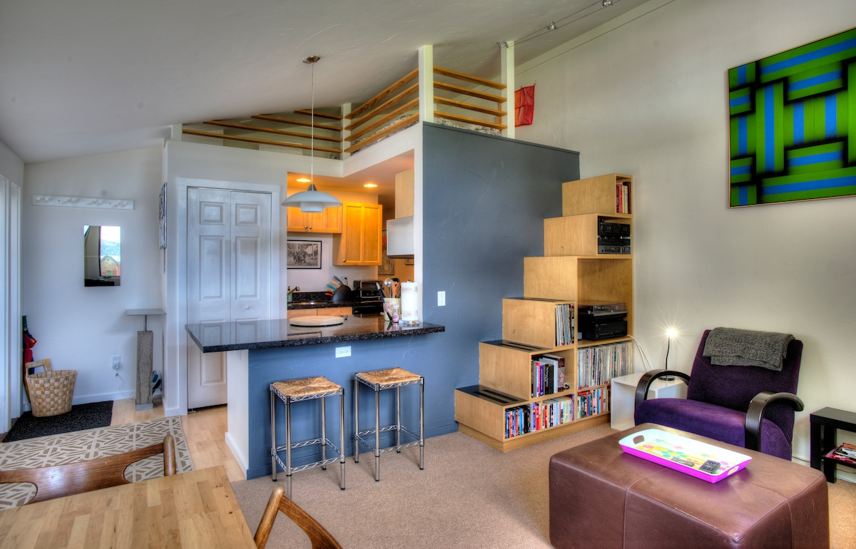 Living room/loft/open kitchen. The loft has a double bed