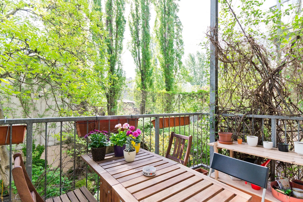 Breakfast, lunch dinner, coffee, beer, chatting, lounging... the balcony hangs over a lovely garden and the canal is just behind those trees