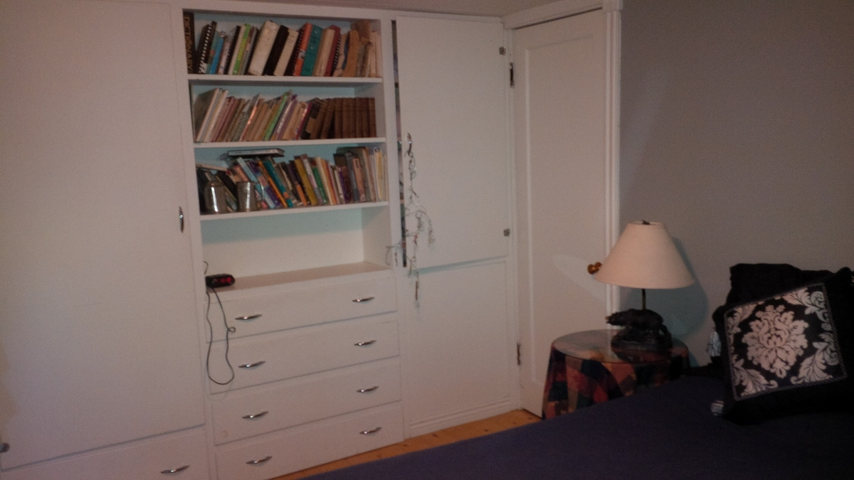 Plenty of built-in closet space in bedroom.