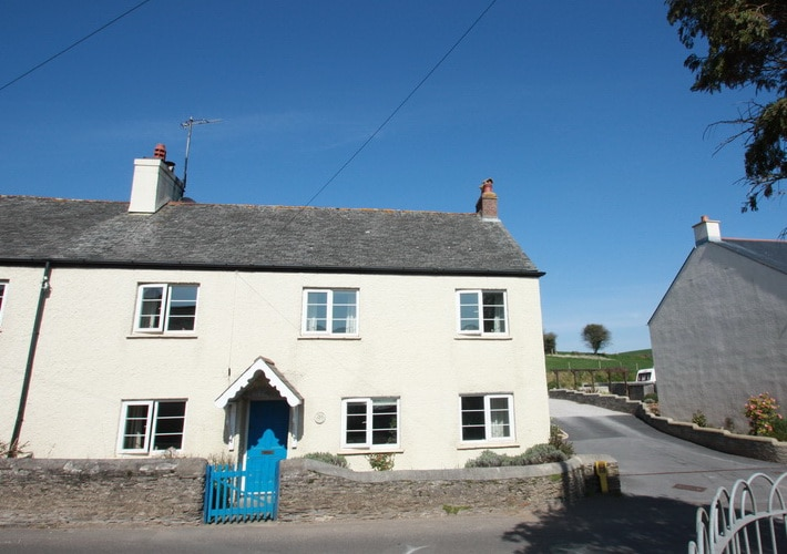 Traditional cottage, cozy sitting room with woodburner and sunny terrace with views