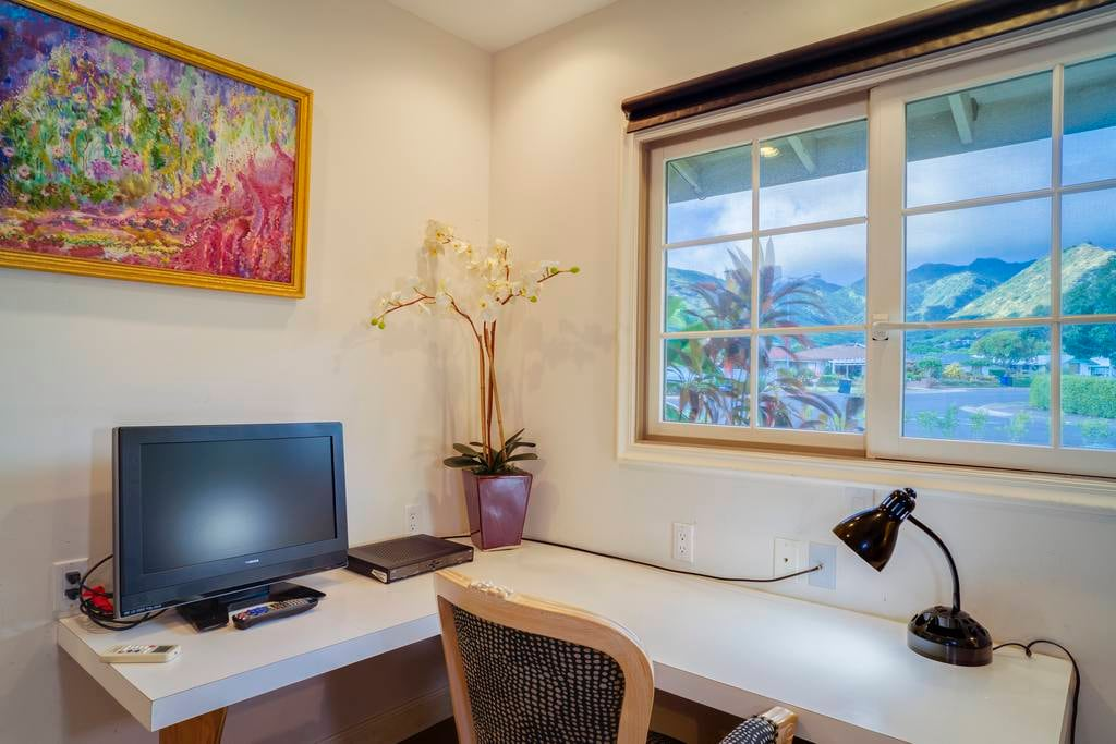 Enjoy the view while you work from this L-shaped desk - or relax with some Dish Network TV or browse wirelessly.