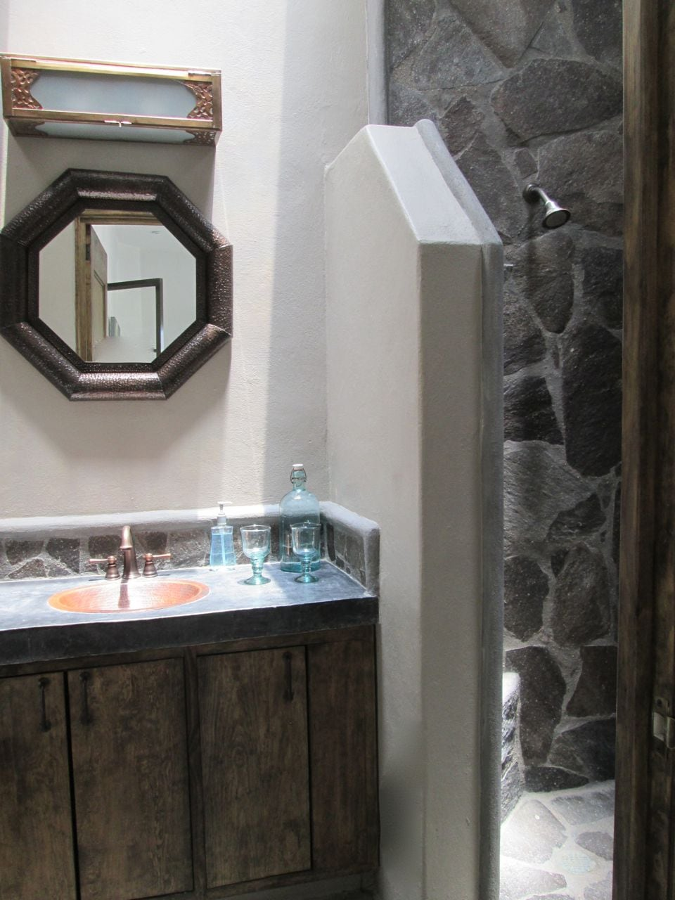 Bathroom with five skylights, stone shower and copper sink