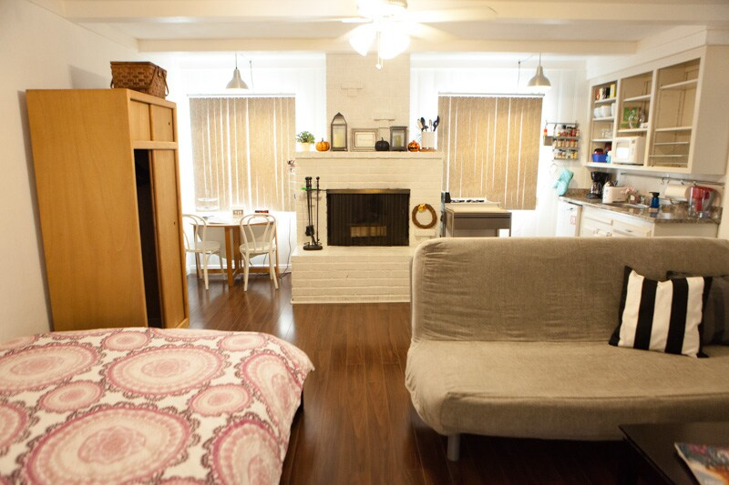 Updated Oct 2014: The view upon entry into the studio. Real queen bed to the left, and comfy futon living room to the right.