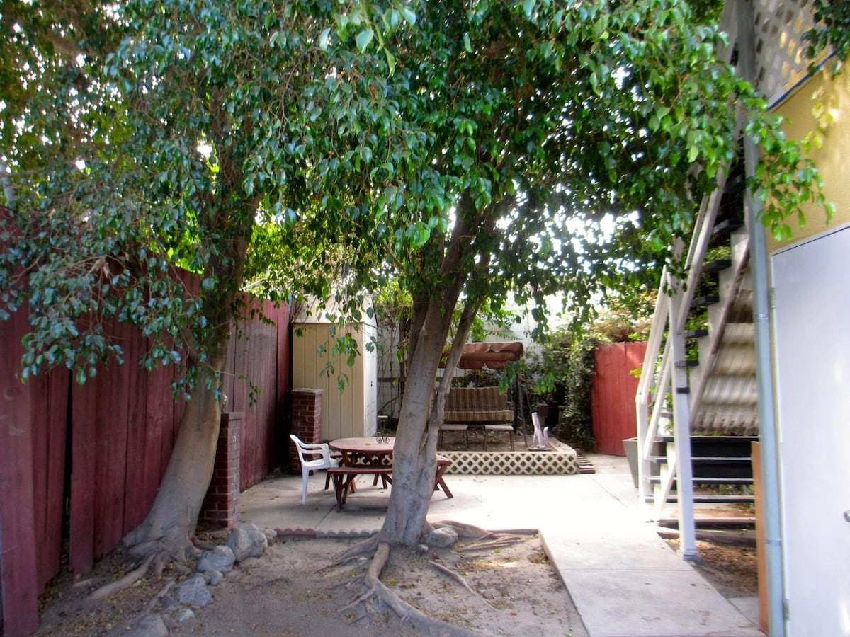 Outside Private Yard area w/ gazbo, chair swing and grill