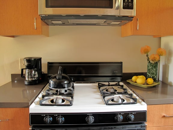 gas range, coffee maker and microwave