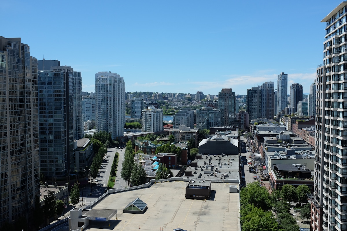 Here's a daytime shot of our view. Our favorite part of the view is the peek-a-boo view of False Creek with the Park on the far shore.