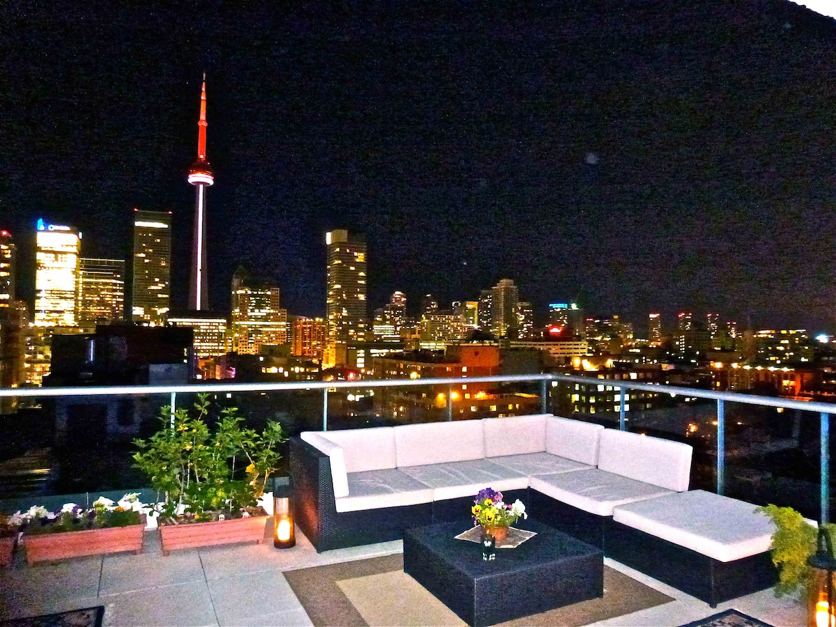 Enjoy Toronto's nightscape with a glass of wine.
