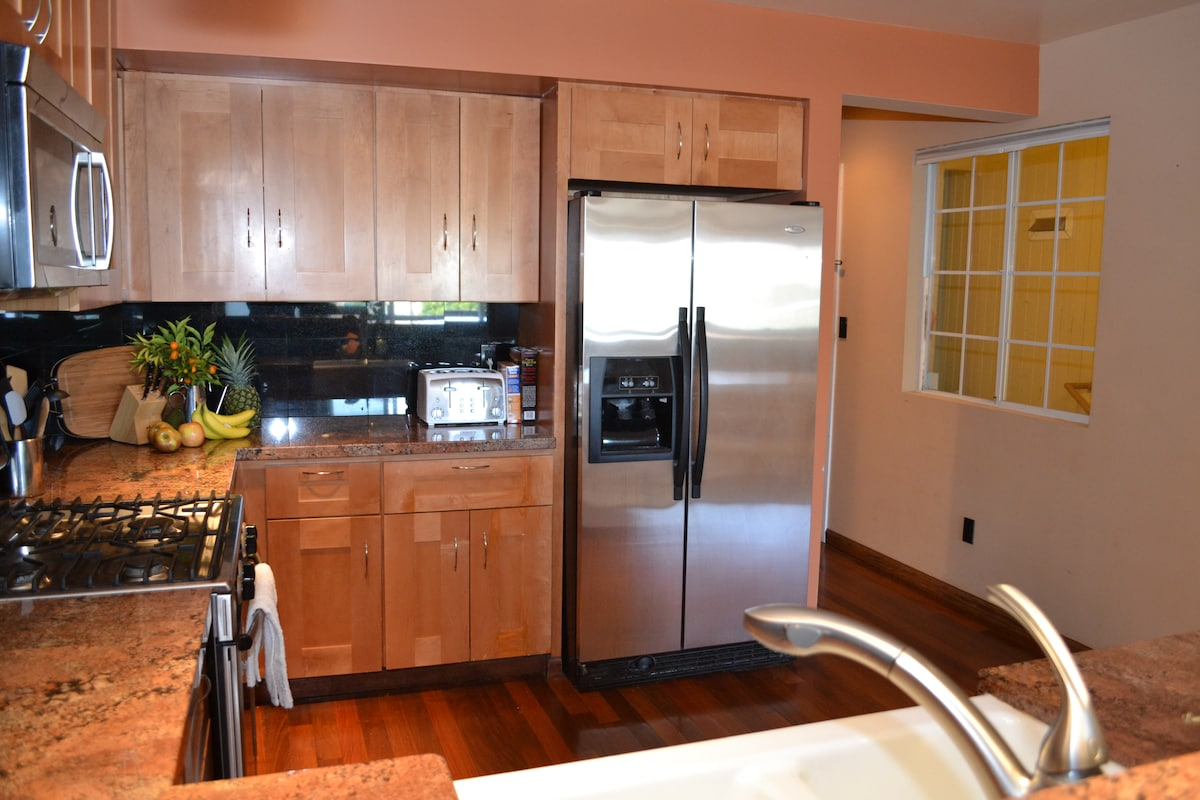 FULL KITCHEN WITH GAS STOVE, MICROWAVE, JUICER, FOOD PROCESSOR, AND TOASTER