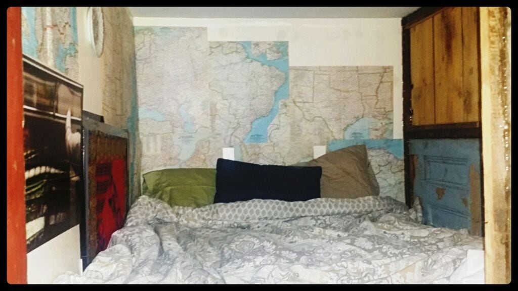 Interior of the loft! Full-size and super comfy memory foam mattress, vintage maps and other art decorations