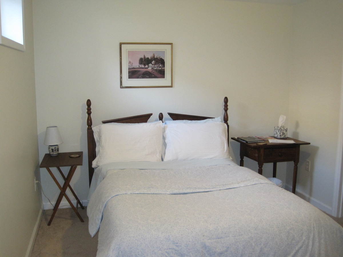 Clean, comfortable bedroom with full size bed.