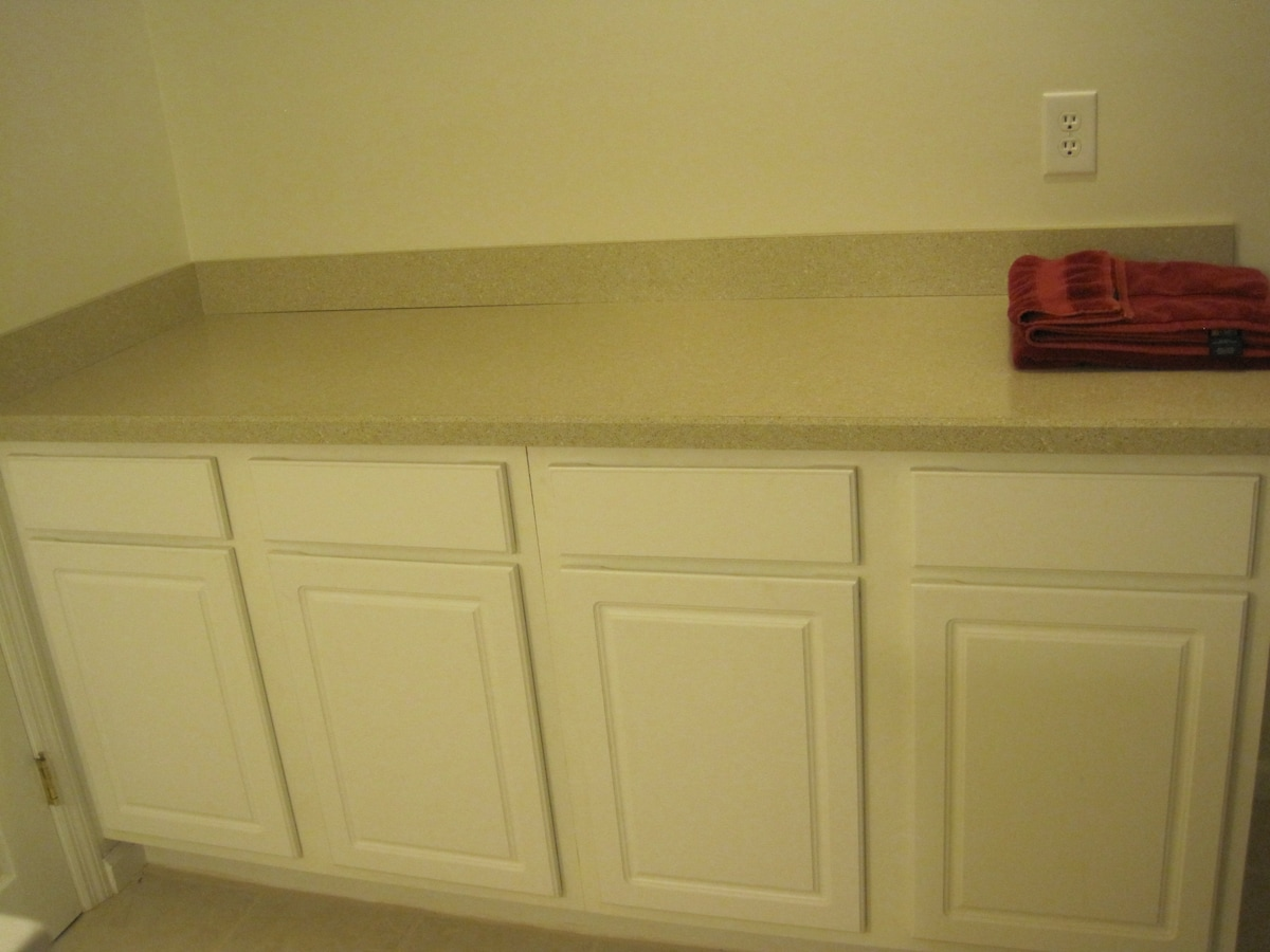 Plenty of counter space to spread out your toiletries in the private bathroom attached to your bedroom.