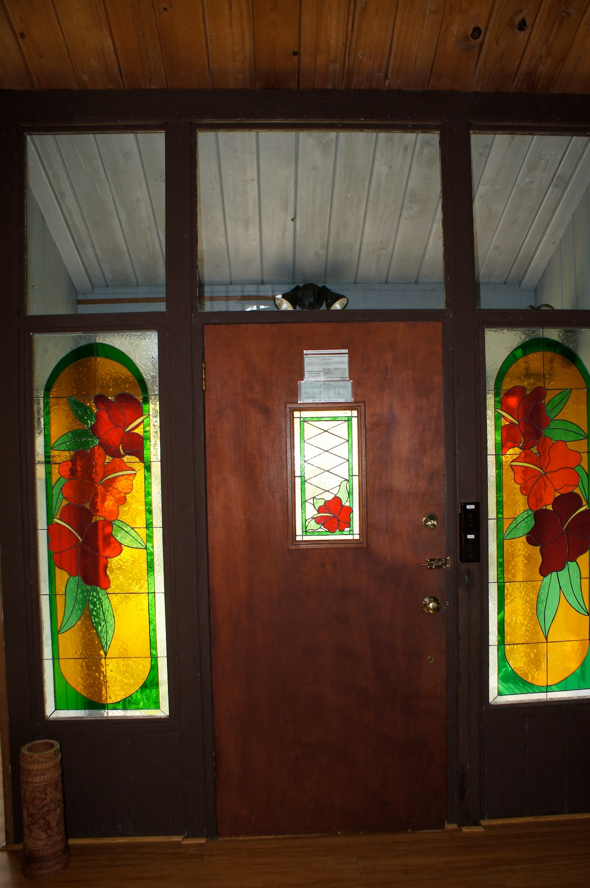 Entry door, viewed from the inside.  There is a motion detector security light for the front porch.