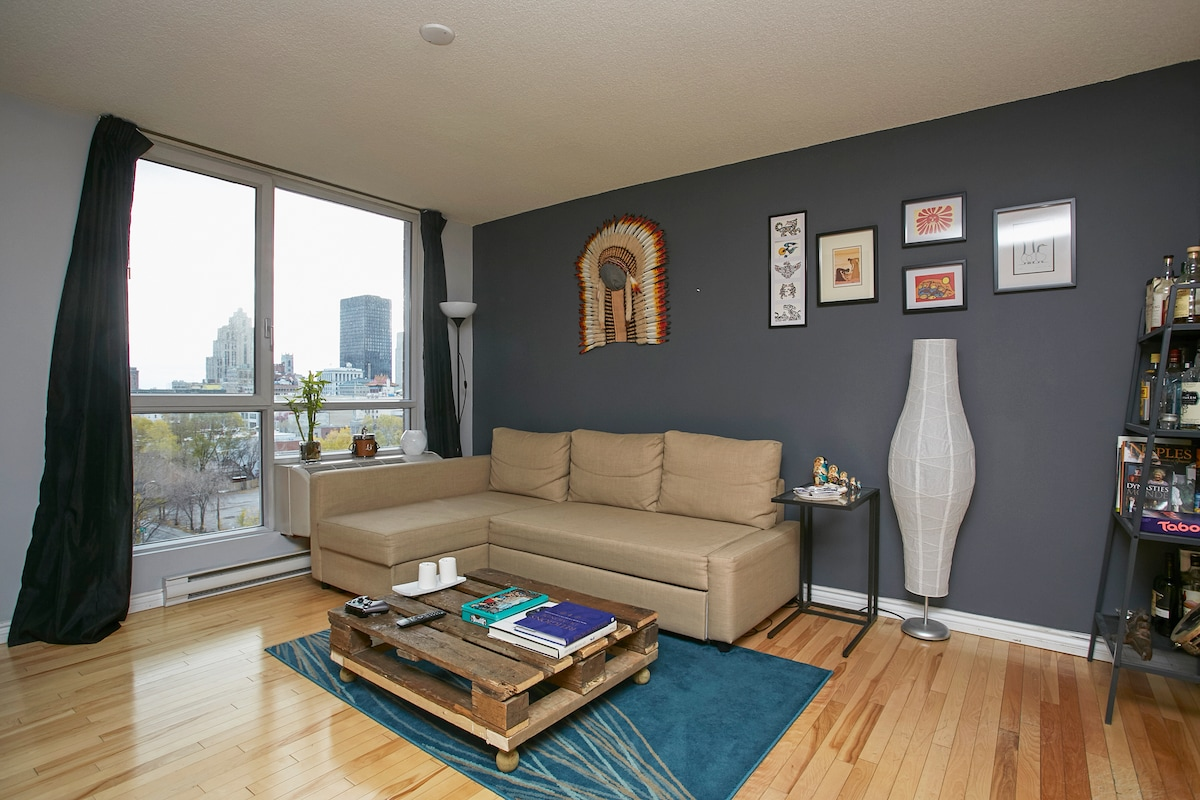 The living room has a sofa-bed, and a great view over downtown Montréal.