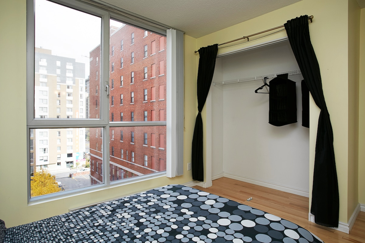 The window overwatches a quiet private park, and a huge wardrobe is available.