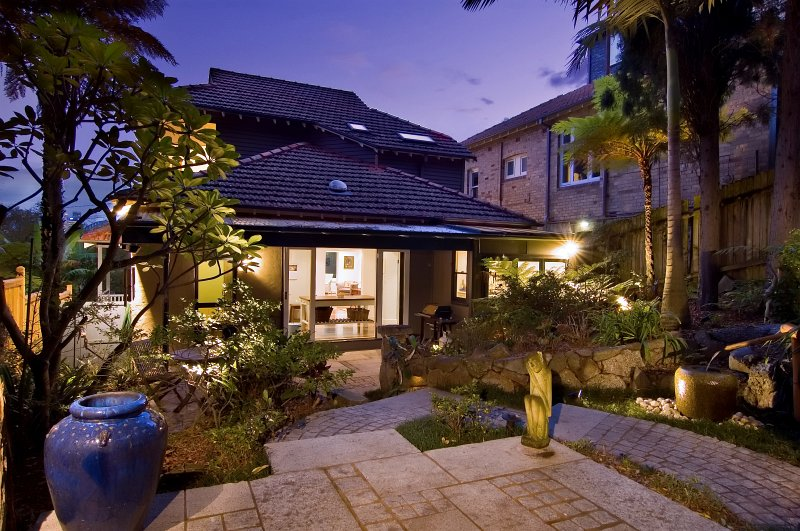 Main house garden shown here at dusk, lies adjacent to the studio. Studio entrance is separate to give guests  privacy in not having to come & go via the main house