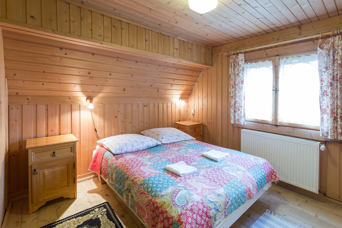 Double bed in large room