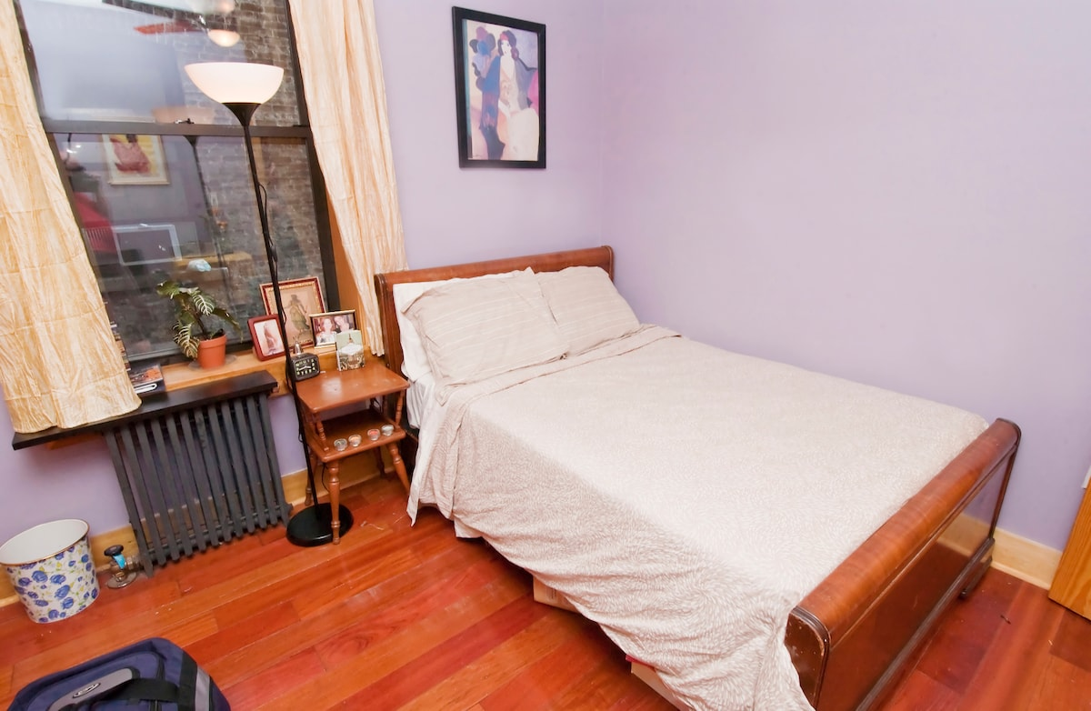 Guest bedroom has a ceiling fan, window and closet. In the summer we install an Air conditioner in that window.