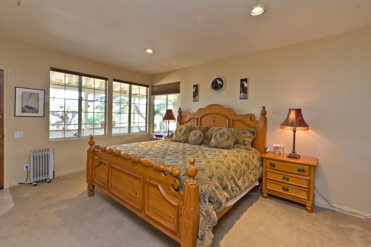 You can view the yard and oak tree from your bed!