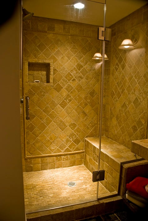 Diagnoal terra cotta tiling and pencil rail make our walk in shower entirely first rate.