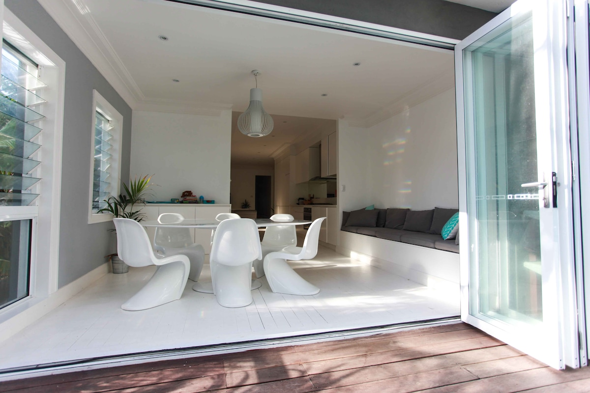 Dining area with foldback bifold doors leading onto the deck.