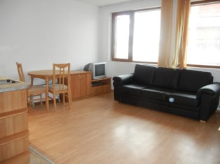 Double sofabed and dining area