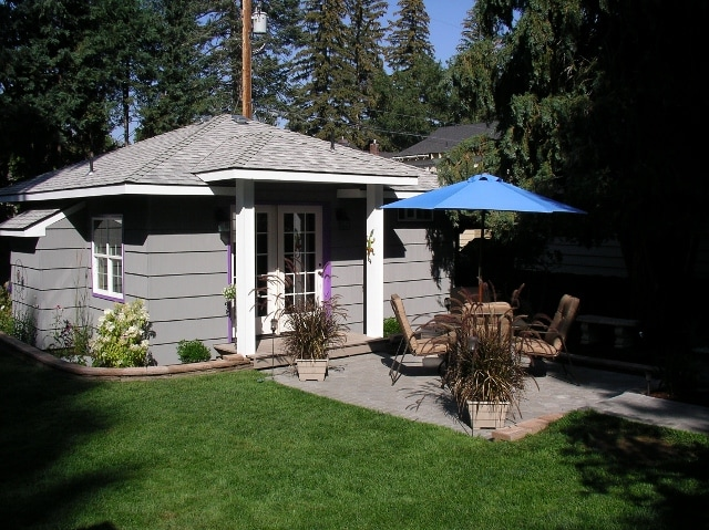 French Doors lead to a wonderfully landscaped yard, patio, BBQ, and natural area