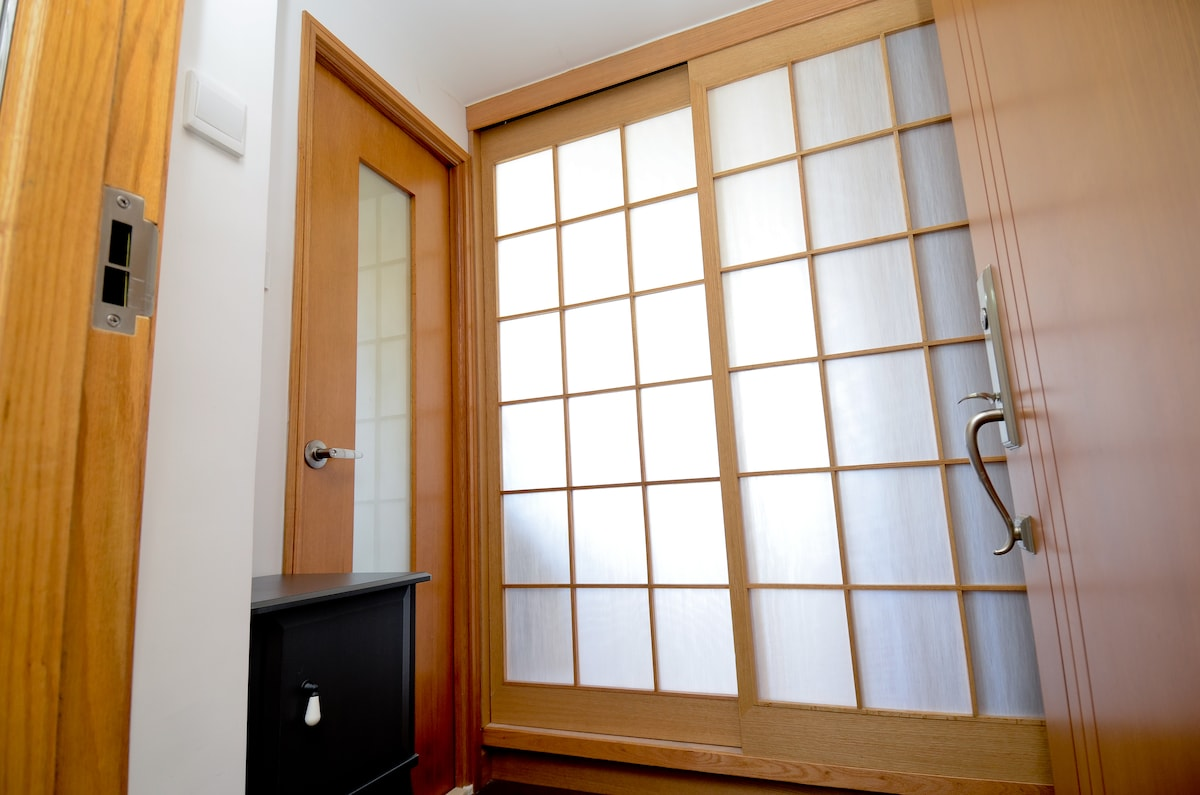 Welcome to my condo: a japanese style folding door front to the bedroom and  (left) bathroom.