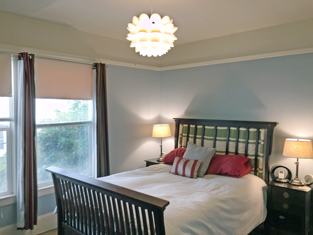 There's a queen-size bed in bedroom with double-pane windows so it'll be quieter.