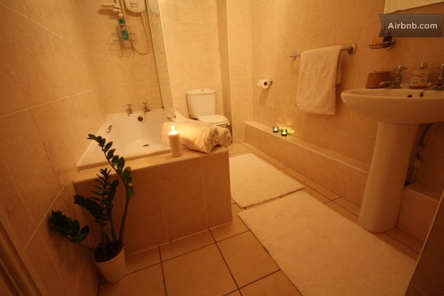 Electric overhead shower and a large tub, air heater