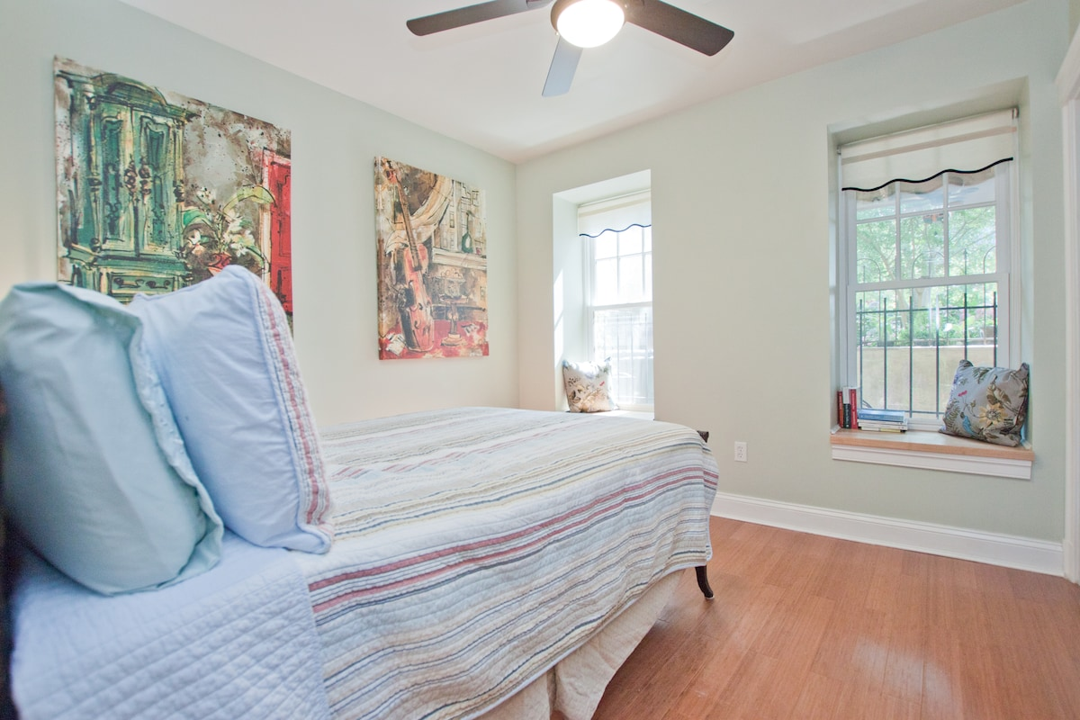 Cheerful yet relaxing 1st bedroom with full sized closet and dresser.