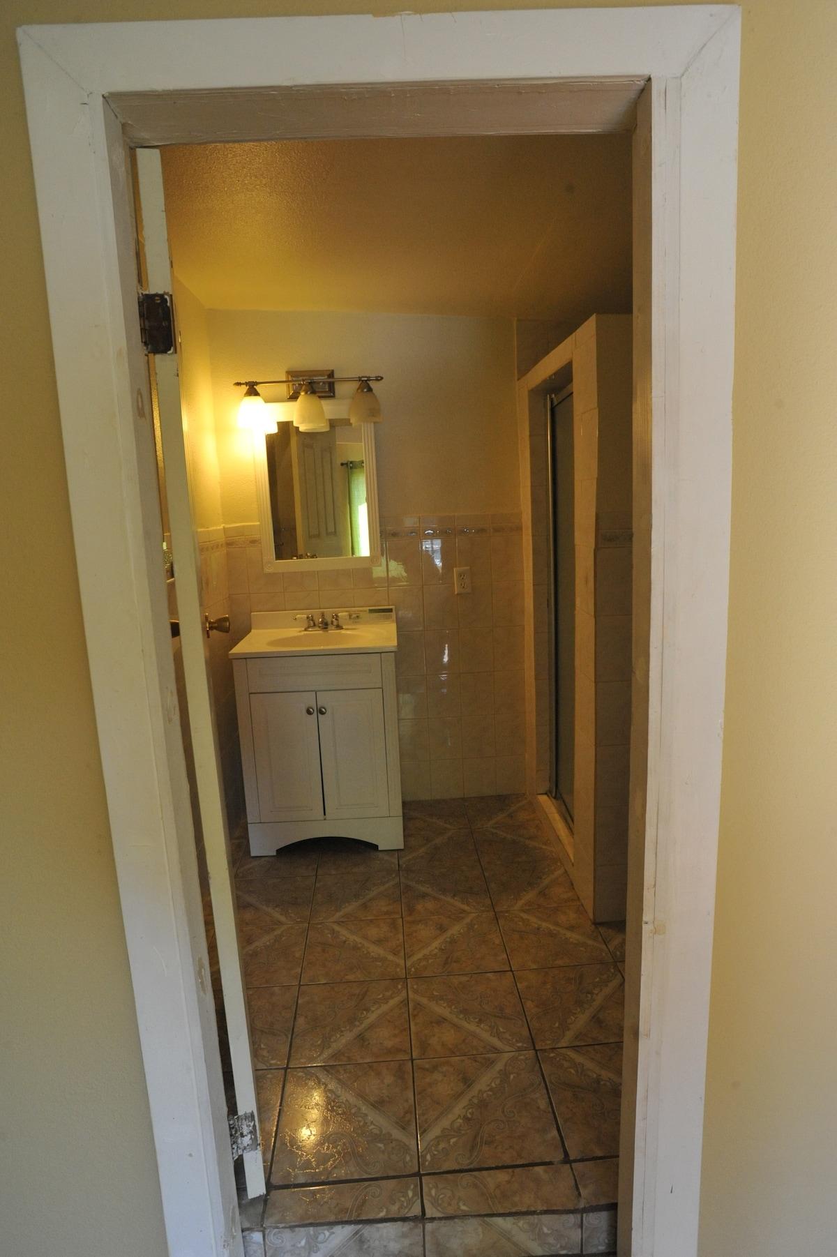Large fully tiled walk in shower.