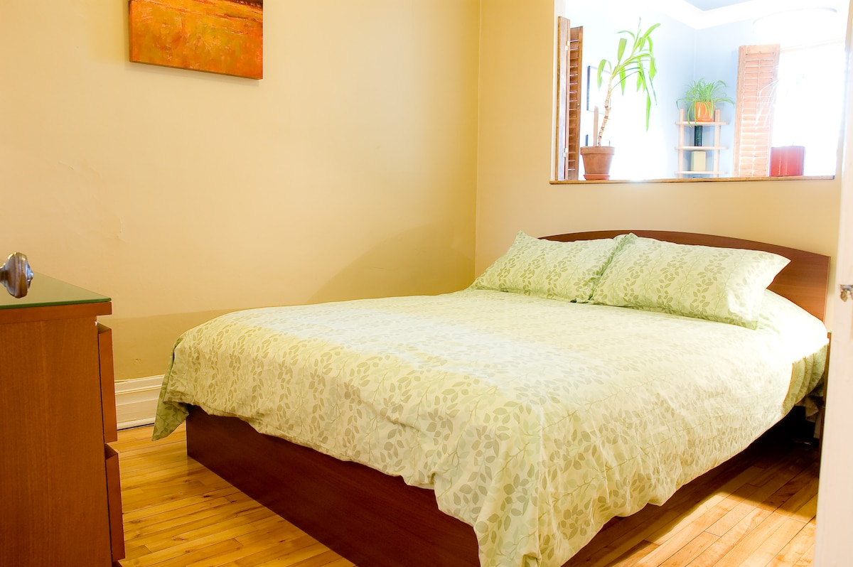 Queen bed in bedroom.  Opening to sitting room (shutters can be closed for more privacy).