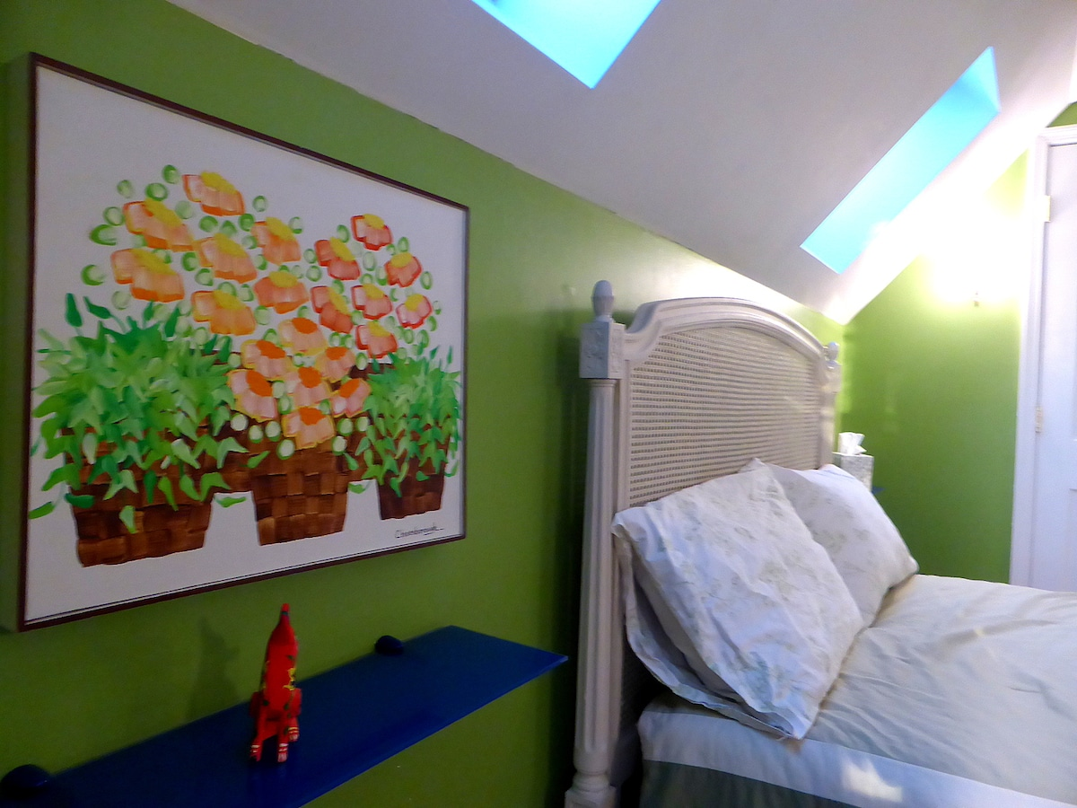 Skylights over the bed add to the sun-filled charm of this room.