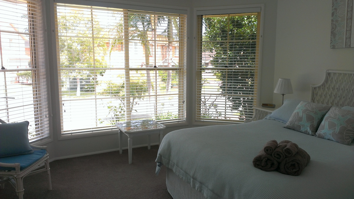 The bedroom has a lovely sunny outlook