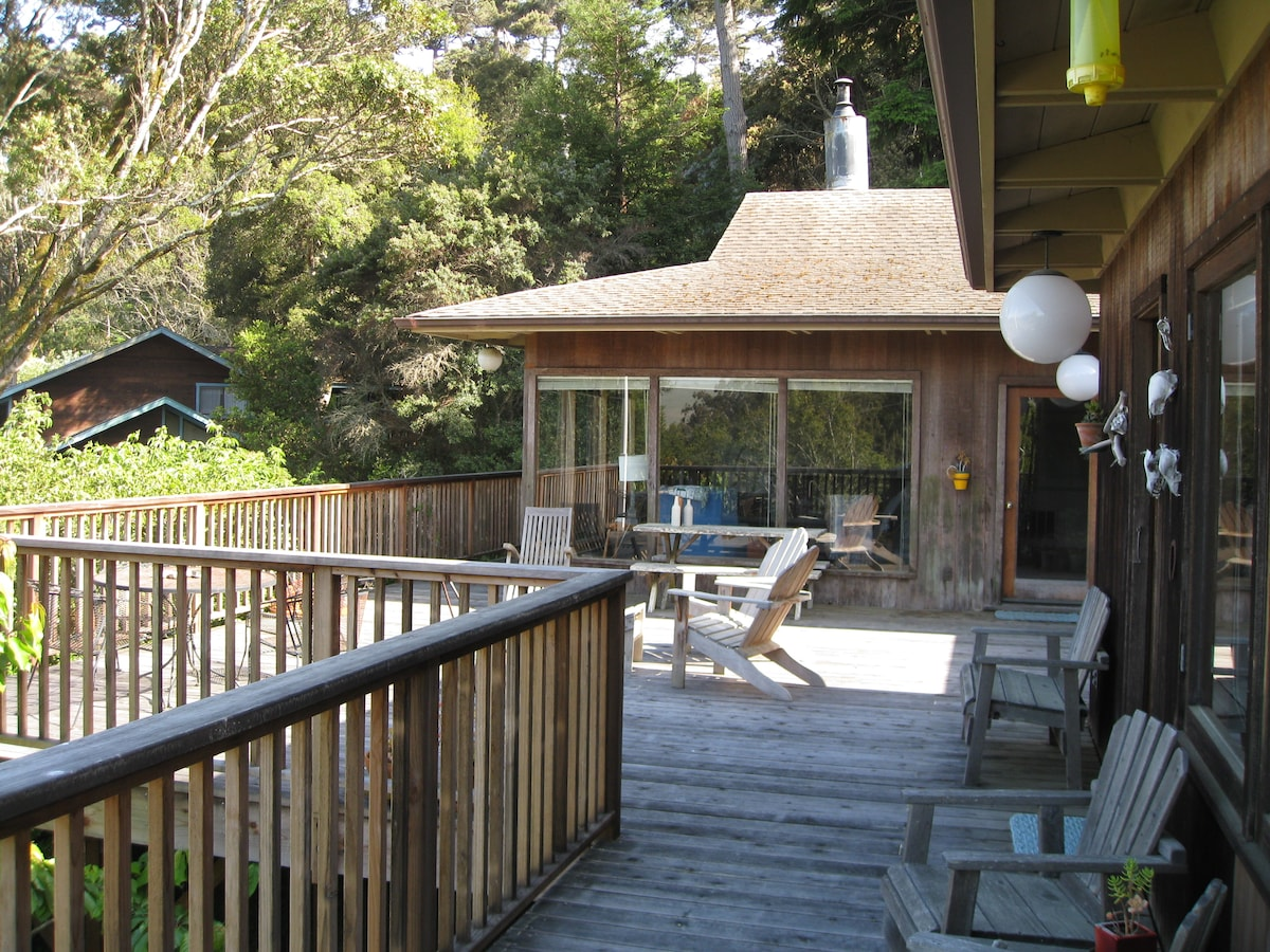 View of deck and main house from in front of the cottage