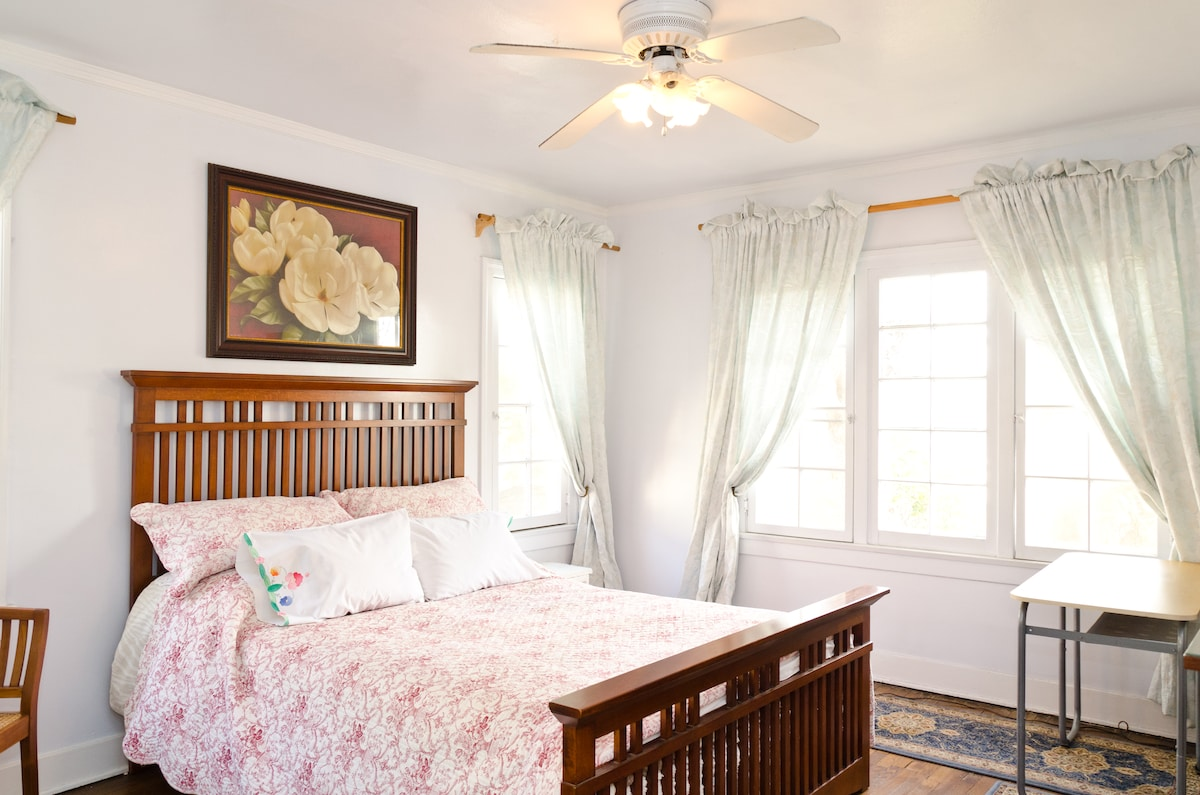 Mission style Queen Size bed in Blue Room, ceiling fan.