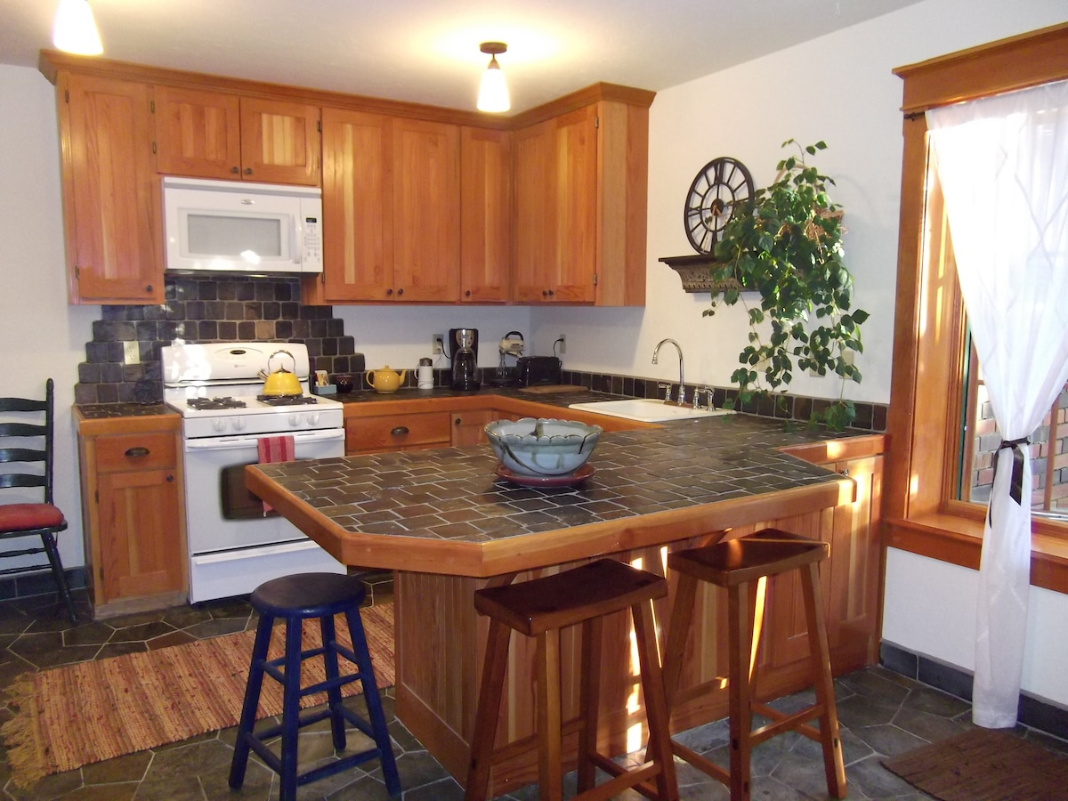 A well-equipped kitchen with new gas range, microwave, energy star dishwasher...local bagels, fruit, coffee, teas