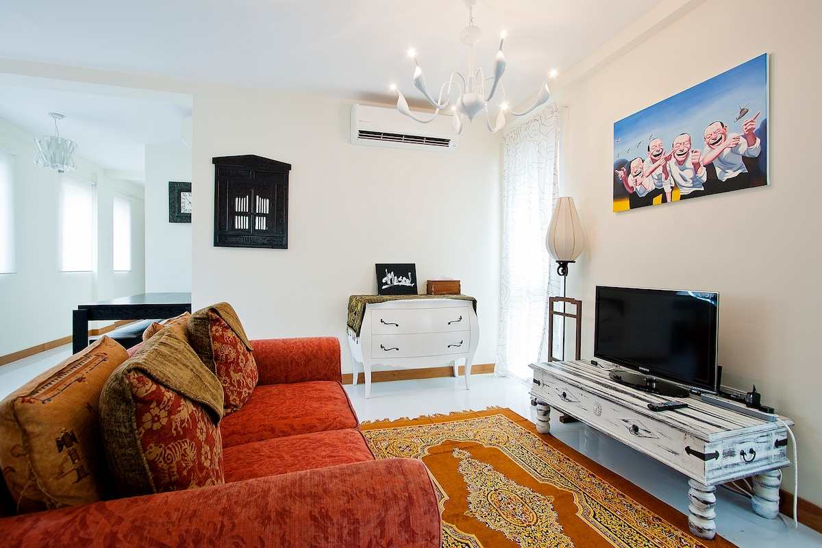 Living room in Balinese decor with humorous Chinese Art! Stretch out and relax after your day out