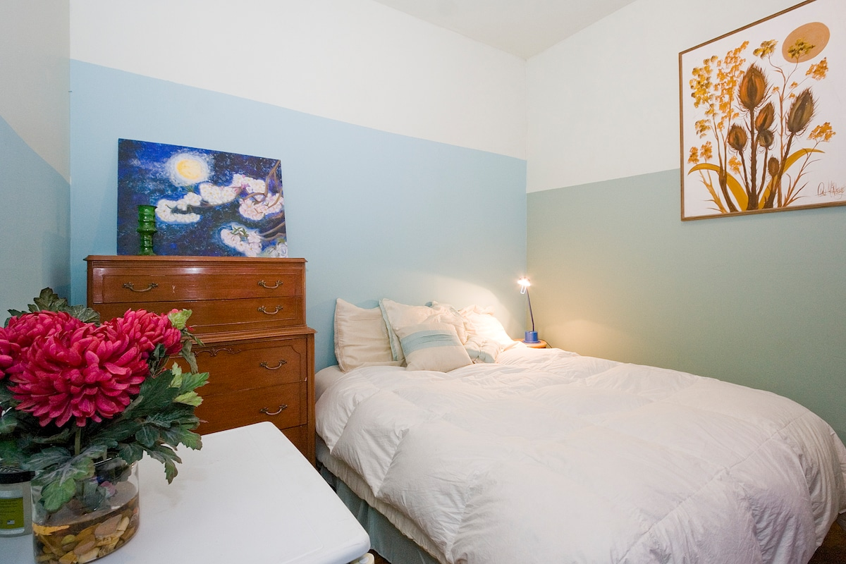 Lovely Room with lockable door and high ceiling.  Note photos are brighter than actual room.