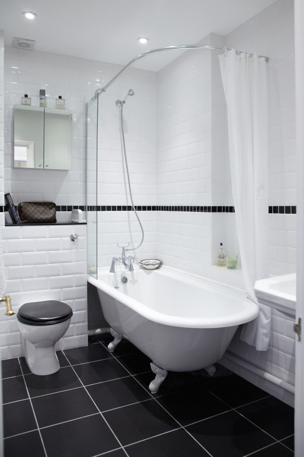 bathroom, with bath with shower over it this is shared by both bedrooms.