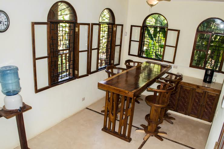 Open kitchen area with Hand -made Teak table and chairs !