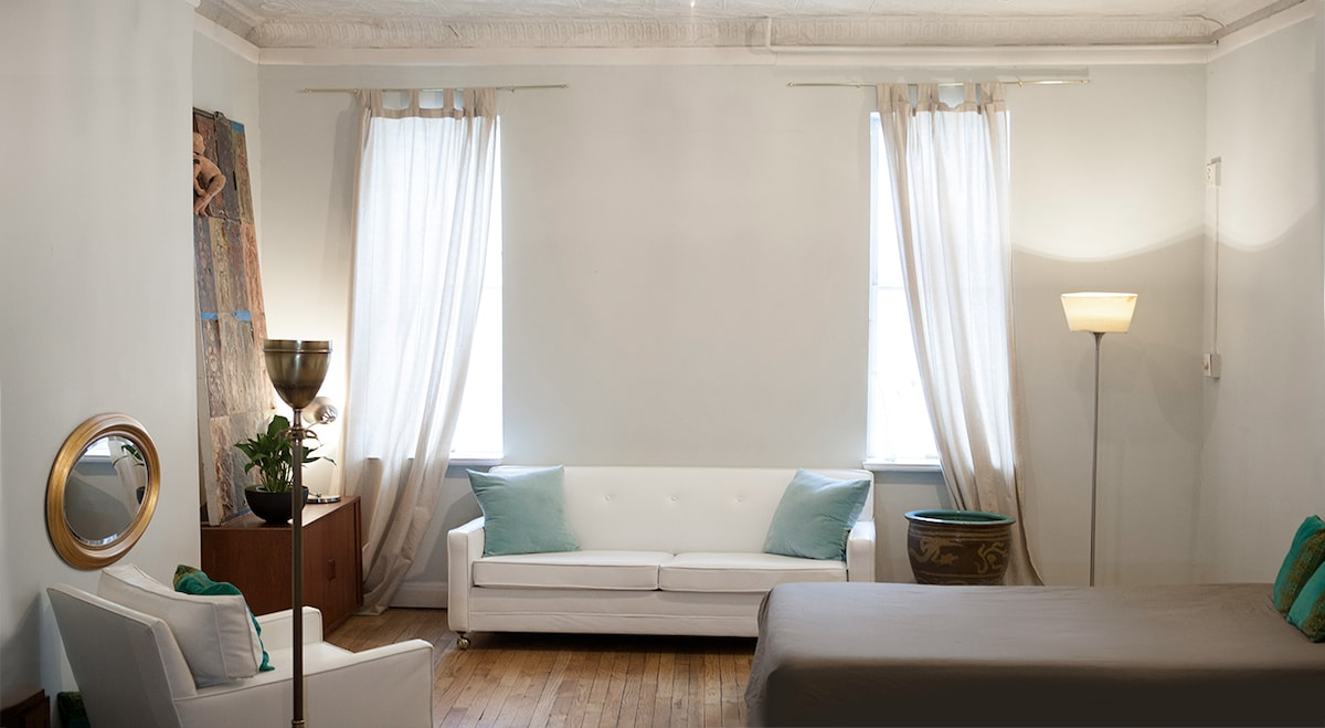 The Hamptons style couch along with a leather chase lounge. The couch pulls out into a super comfortable full sized bed.