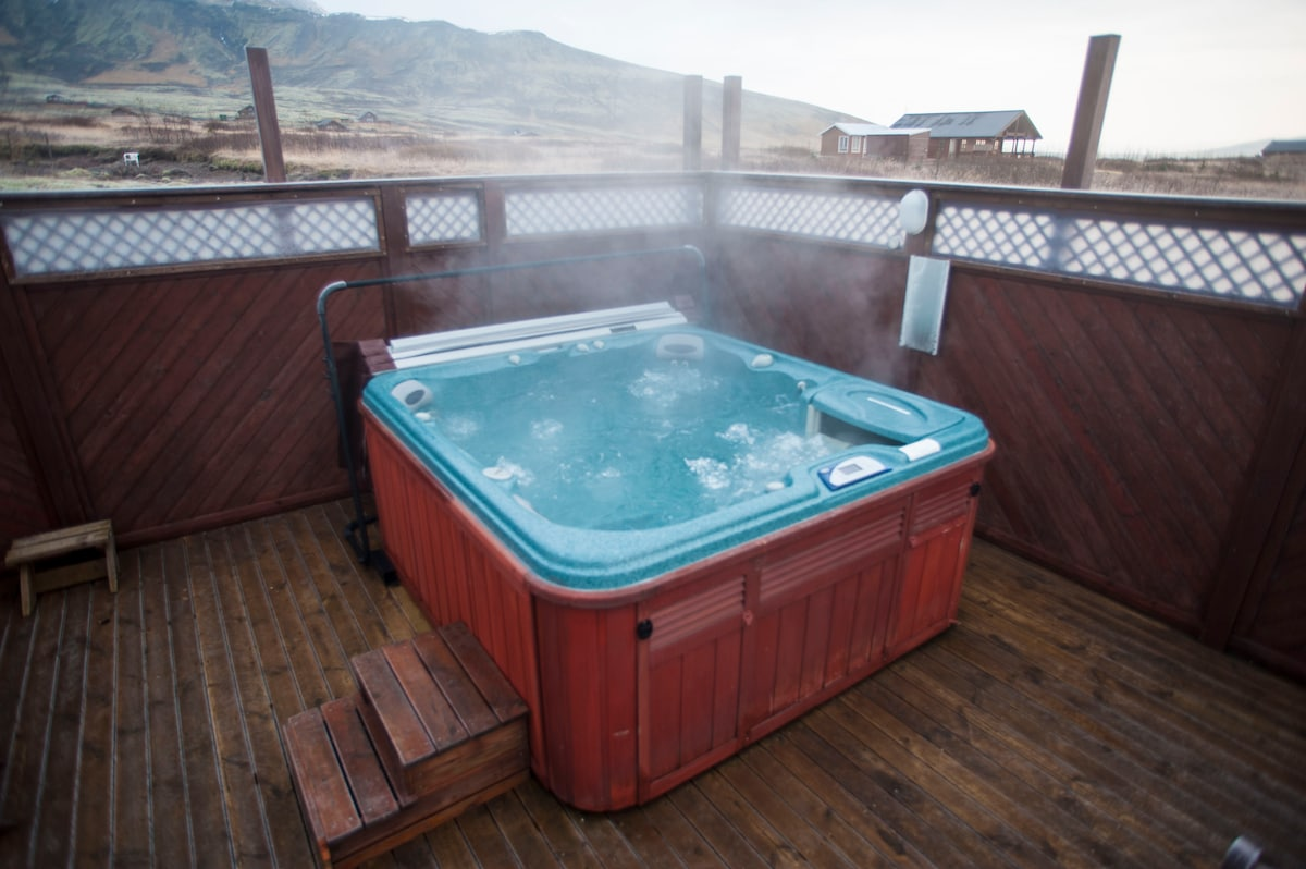 The jacuzzi on the terrace and a view of the mountain at the back of the house.