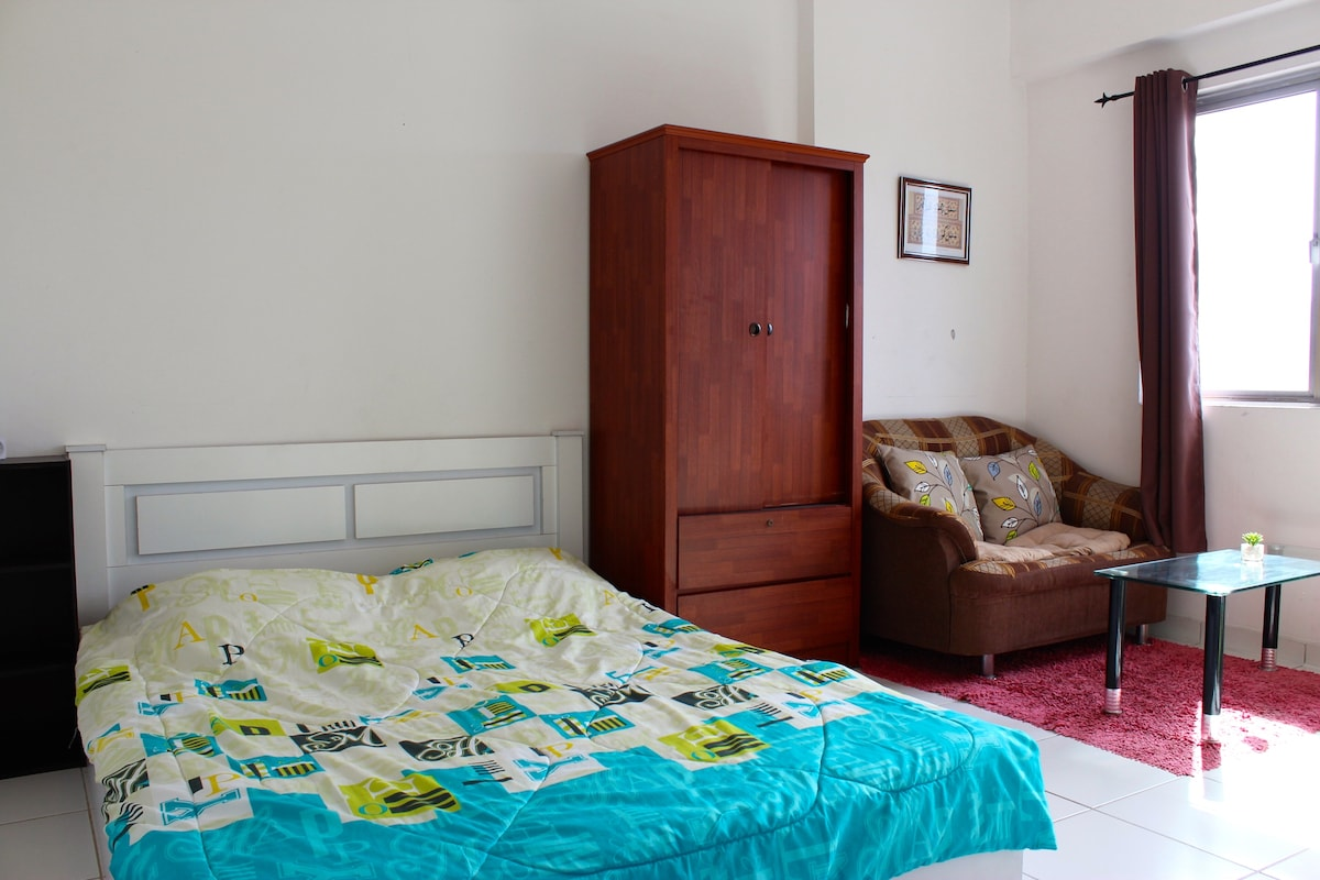 Updated photo showing King Bed, wardrobe, sofa and mini-frige