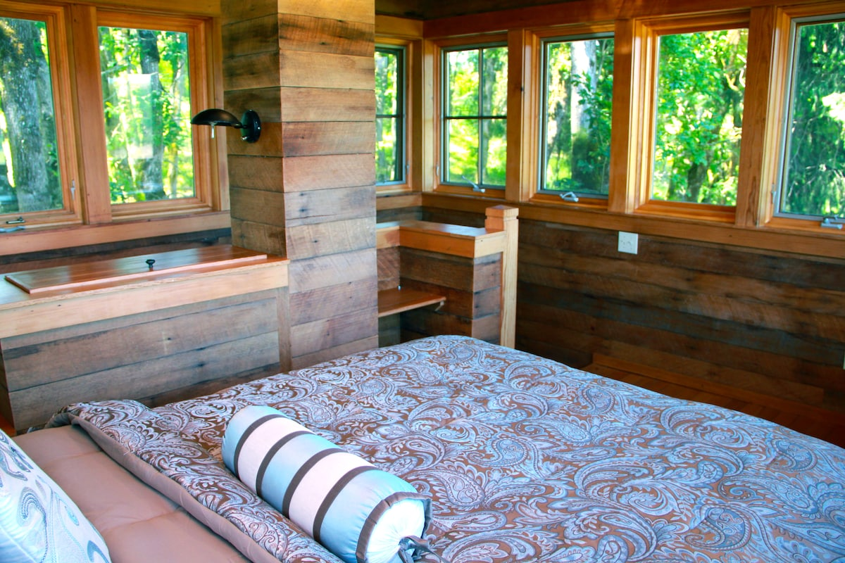 Bedroom sits on second floor and provides spectacular 360 degree view of the vineyard and the valley - look at all those windows!