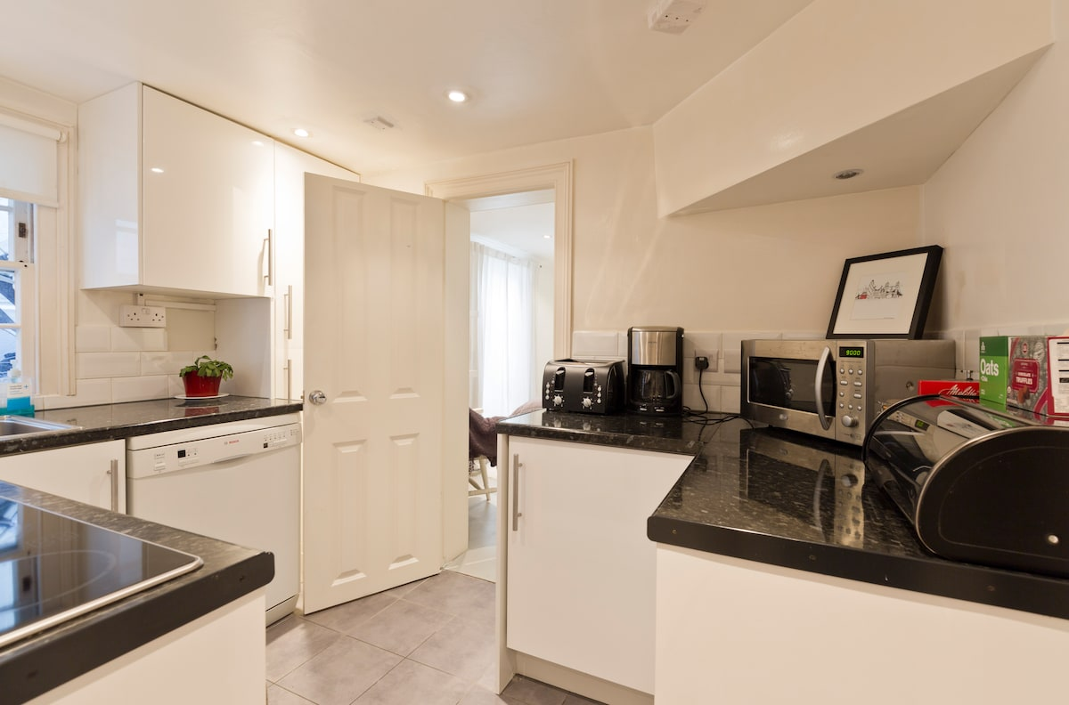 Well appointed kitchen with dishwasher, microwave, electric hob / oven, fridge freezer, coffee maker etc. Washer/drier located in large cupboard in entrance hall with iron and board etc.