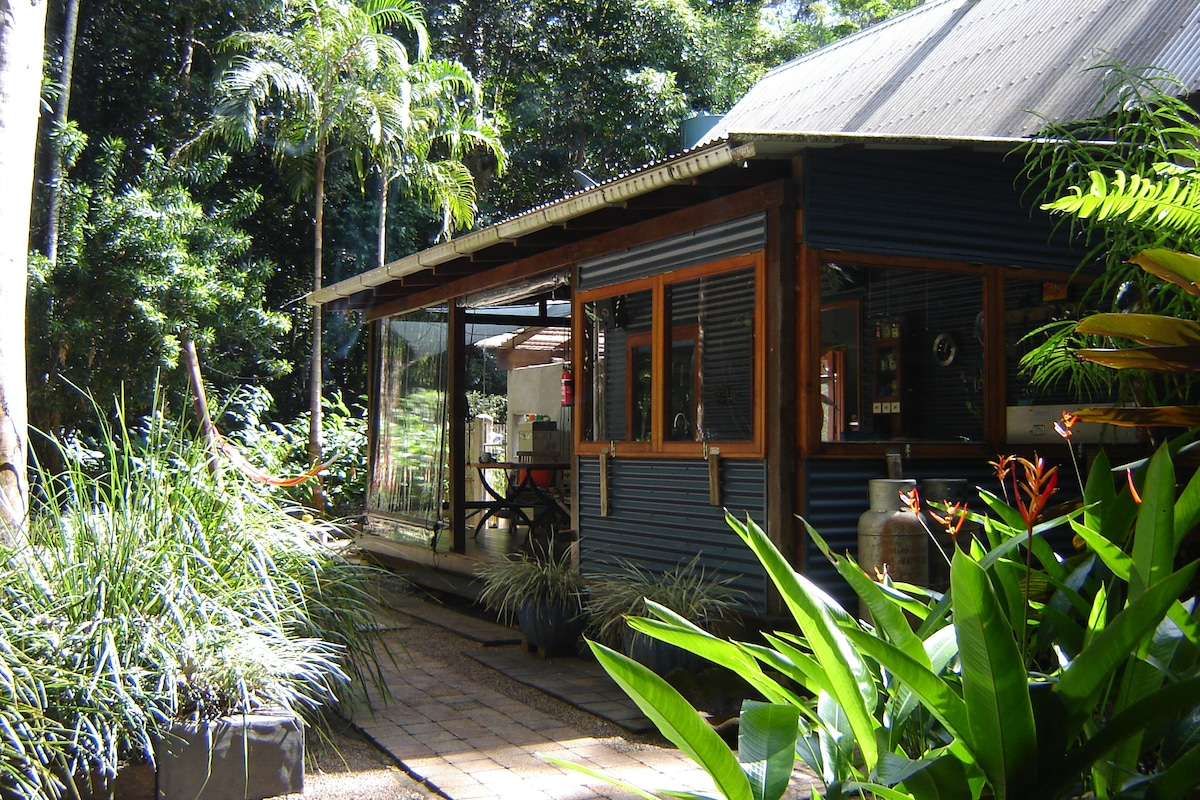 Beautiful gardens surround the house and attract lots of beautiful wildlife.  There are views of the forest from every room