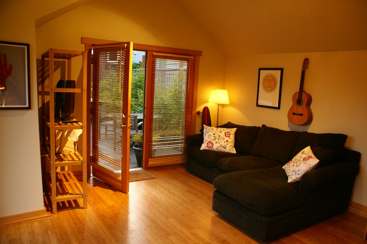 Salvaged fir french doors open into the living area.