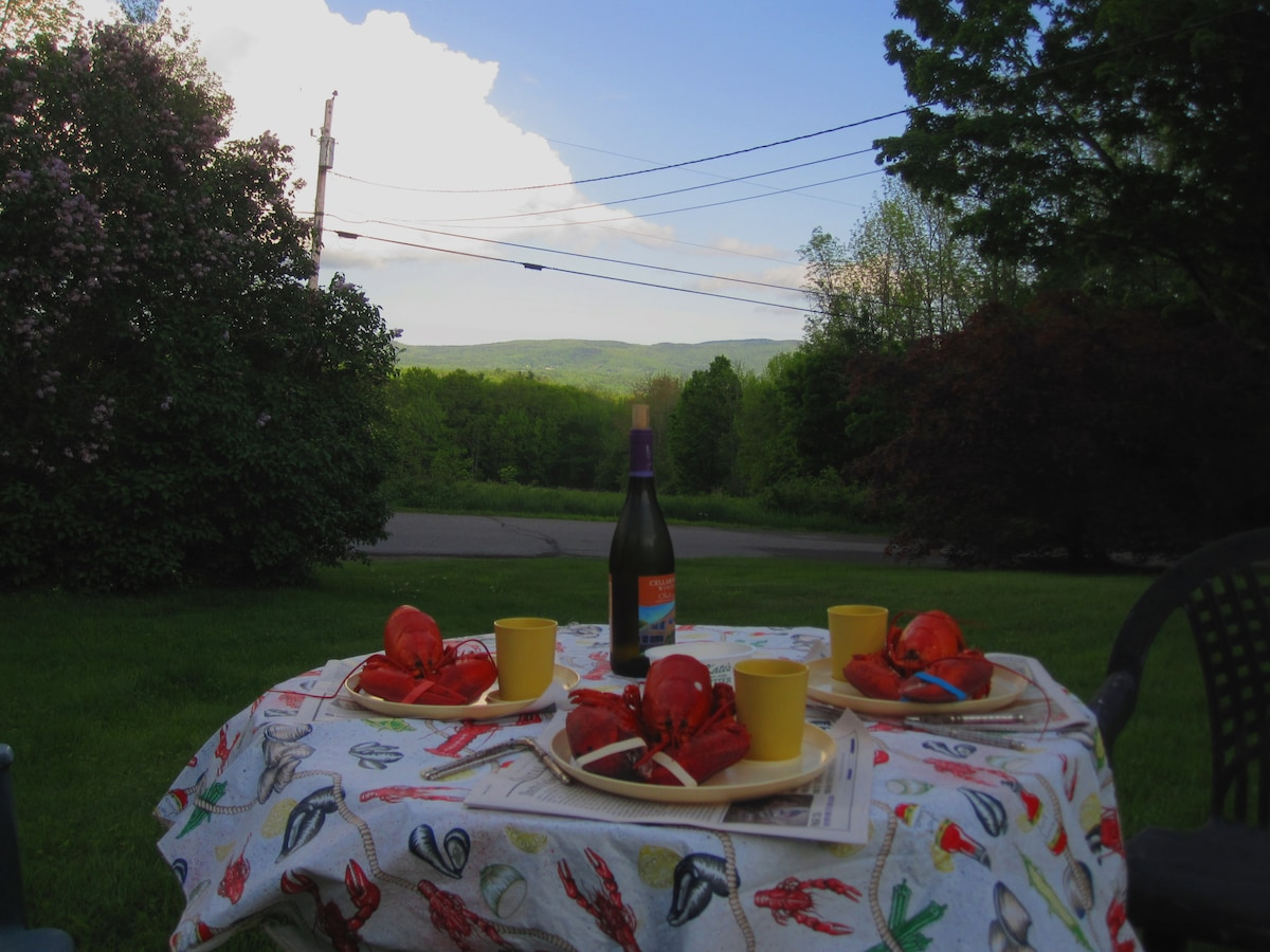 a lobster picnic on the lawn, with a bottle of wine from the local vineyard